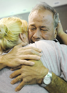 Globe/T. Rob Brown Bob Harbottle, who lost his Joplin home, gets a hug from fellow church member Wendy Chapman, of Diamond, during a community prayer service Wednesday evening, May 25, 2011, for all affected by Sunday's tornado, at the Joplin Family Worship Center on East 7th Street.