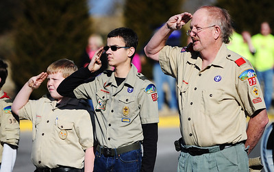Boy Scouts of America Troop 39 members salute during the playing of the National Anthem prior to the start of the Chilly Challenge 5K run Wednesday morning , Jan. 1, 2014, at the Joplin Family Y South. Globe | T. Rob Brown