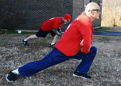 Patrick Nine of Carthage stretches Wednesday morning , Jan. 1, 2014, prior to the Chilly Challenge 5K run at the Joplin Family Y South. Globe | T. Rob Brown