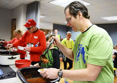 Lance Borup of Joplin grabs a bowl of chili follwing the Chilly Challenge 5K run Wednesday morning , Jan. 1, 2014, at the Joplin Family Y South. Globe | T. Rob Brown