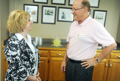 Globe/Roger Nomer New United Way Director Bev Crespino-Graham talks with Steven Lohr, executive director of Southeast Kansas Community Action Program, during a reception on Thursday.