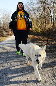 Kim Fowler of Carl Junction walks her dog Sam along the Frisco Trail near Royal Heights in Joplin. Globe | T. Rob Brown