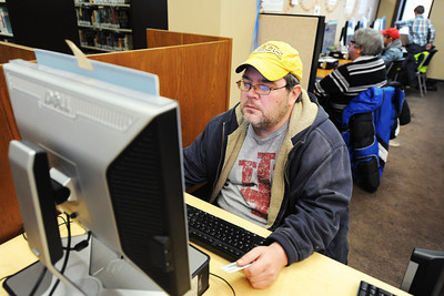 Michael Eggensperger of Joplin and other Joplin Public Library patrons utilize the computer lab Thursday afternoon, Dec. 12, 2013. Globe | T. Rob Brown