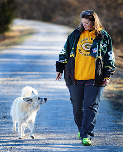 Companions Kim Fowler of Carl Junction and her dog Sam walk along the Frisco Trail near Royal Heights in Joplin. Globe | T. Rob Brown