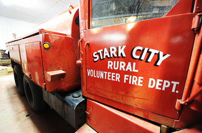 One of the old Star City Fire Department tanker trucks Thursday afternoon, Jan. 9, 2014, at the department. The department hopes to combine with the Fairview Fire Department and get a tax levy to make necessary upgrades. Globe | T. Rob Brown