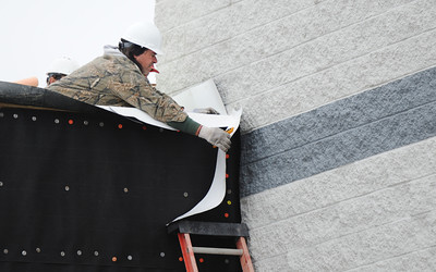Chris Long, a roofer with Mid-America Roofing of Frontenac, Kan., works on the roof of the new expansion Wednesday afternoon, Jan. 8, 2014, at Spring Grove Elementary School in Galena, Kan. Globe | T. Rob Brown