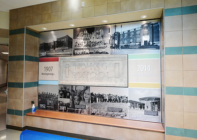 Some of Irving Elementary School's history is displayed on one of the front interior walls at the new Irving Thursday afternoon, Jan. 2, 2014. Globe | T. Rob Brown