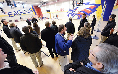 Representatives from architectural firm Sapp Design Associates and consulting engineers Toth & Associates, Inc. tour the new Irving Elementary School Thursday afternoon, Jan. 2, 2014. The school's gymnasium doubles as a community tornado shelter. Globe | T. Rob Brown