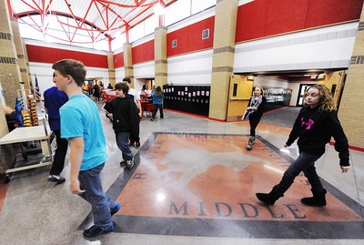 Baxter Springs (Kan.) Middle School students walk through the new school's main cooridor Wednesday afternoon, Jan. 8, 2014, between classes. Globe | T. Rob Brown