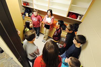 Principal Teresa Adams (center) of Soaring Heights Elementary School takes a group of fourth and fifth graders on a tour Thursday afternoon, Jan. 2, 2014, at the new Duquesne school. Soaring Heights combines the students from Duquesne and Duenweg elementary schools. Globe | T. Rob Brown