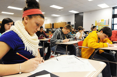 Baxter Springs (Kan.) Middle School eighth grader Kortney Sills (left) takes notes on the skeletal system during Stephanie Dewey's science class Wednesday afternoon, Jan. 8, 2014, at the new middle school. Globe | T. Rob Brown