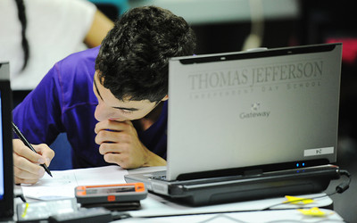 Globe/T. Rob Brown Thomas Jefferson Independent Day School sophomore Michael Joseph takes a practice SAT Monday afternoon, July 29, 2013, in a school computer lab.