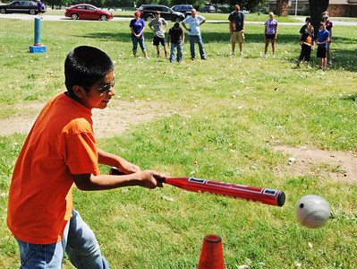 Globe/T. Rob Brown Adrian Marcos, 13, of Anderson, puts the beeperball into play during the United Way Day of Action Friday morning, June 21, 2013, at Schifferdecker Park. Marcos, who is visually impaired, is helped through the Joplin Association for the Blind which receives funding from the United Way.