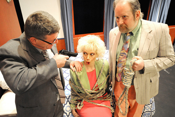 "Arlene, portrayed by Marilyn Marshall-Six, finds herself in a pickle as her husband, Paul (Roscoe Miller) and lover/dentist Mitchell (Richard Roberts) exact their revenge during rehearsal for ""Murder at the Howard Johnson's"" on Tuesday night at Joplin Little Theatre. The comedy, set in the 1980s is directed by Jade Nicholas and opens March 26. Globe 