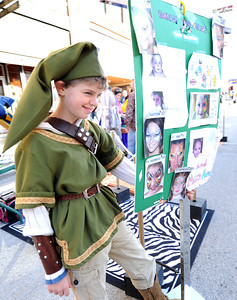 "Grayson Hall, 12, of Kansas City, dresses as his favorite character, ""Link"" from The Legend of Zelda video game during Thurd Thursday on Main Street. Globe 