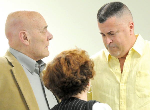 An emotional Mark Rohr, right,  chats with Don and Donna Landrith during a reception for Rohr on Tuesday Night at Central Christian Center. Rohr, Joplin's ex-city manager, was hired by the council upon which Landrith served. Globe | Laurie Sisk