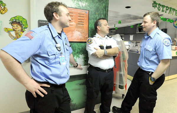 Crowder College EMS Clinical Supervisor and Paramedic Instructor Ike Isenhower, center, chats with international paramedic students Ian Kearney, left and Andy O'Connell, both of Dublin, Ireland on Wednesday at Freeman West Hospital. Globe | Laurie Sisk