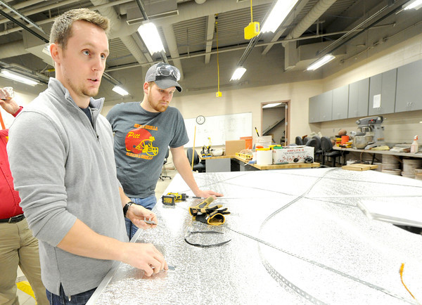 Pittsburg State seniors Cody Frieden and Austin Leake discuss the advantage of snap together hinges on  their rapidly deployed shelter on Thursday at the Kansas Technology Center. Globe | Laurie Sisk