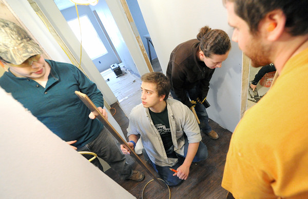 From the left: University of Connecticut students Peter Larson, Rob Neubauer, Jane Moran and T.J. Green install laminate wood floors in a house at 2018 Annie Baxter on Wednesday. The four are part of a group of about 20 Connecticut students spending their Spring Break helping Rebuild Joplin. Globe | Laurie Sisk