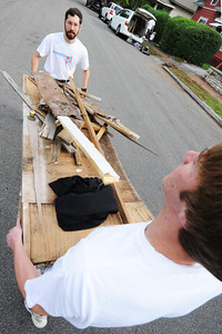 Globe/T. Rob Brown Nathan Jordan, left, of Joplin, and Michael Judd, an Ozark Christian College junior psychology counseling major from Blue Springs, carry a load of yard and other debris on Wall Avenue to a nearby dumpster Sunday morning, Sept. 30, 2012, during the Great Day of Service in Joplin.