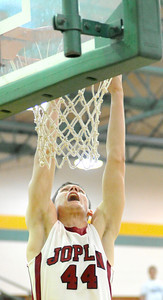 Joplin's Spencer Layne throws down a dunk off a rebound during the Eagles' game against Neosho on Tuesday night at Robert Ellis Young Gymnasium. Globe | Laurie Sisk