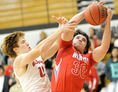 Carl Junction's Chase Johnston tries to stop Webb City's Tayler Arterburn during their game on Tuesday night at Carl Junction. Globe | Laurie Sisk