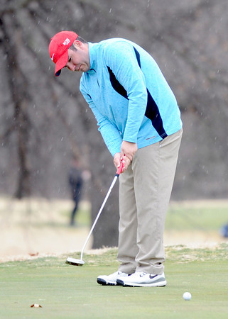 Webb City High School golfer Colton Craig watches his putt roll toward the cup as a cold rain and brisk winds hit the course on Wednesday at Brairbrook Country Club. Globe | Laurie Sisk