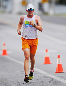 Winner of the men's marathon, Michael Bredehoft, of Clearwater, Kan., has a decisive lead as he runs through downtown Baxter Springs, Kan., Sunday morning, Oct. 13, 2013, during the Mother Road Marathon. Globe | T. Rob Brown